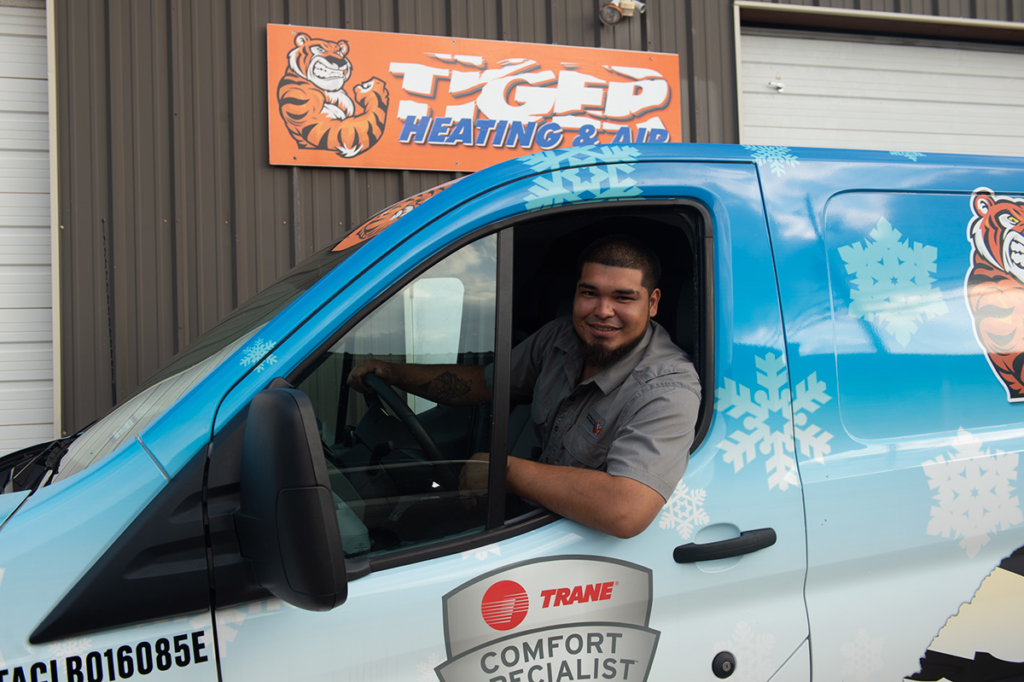 Tiger Heating & Air ac installation tech in van outside our Corpus Christi location