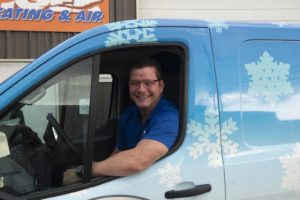 Owner of Tiger Heating & Air in Corpus CHristi driving hvac vehicle