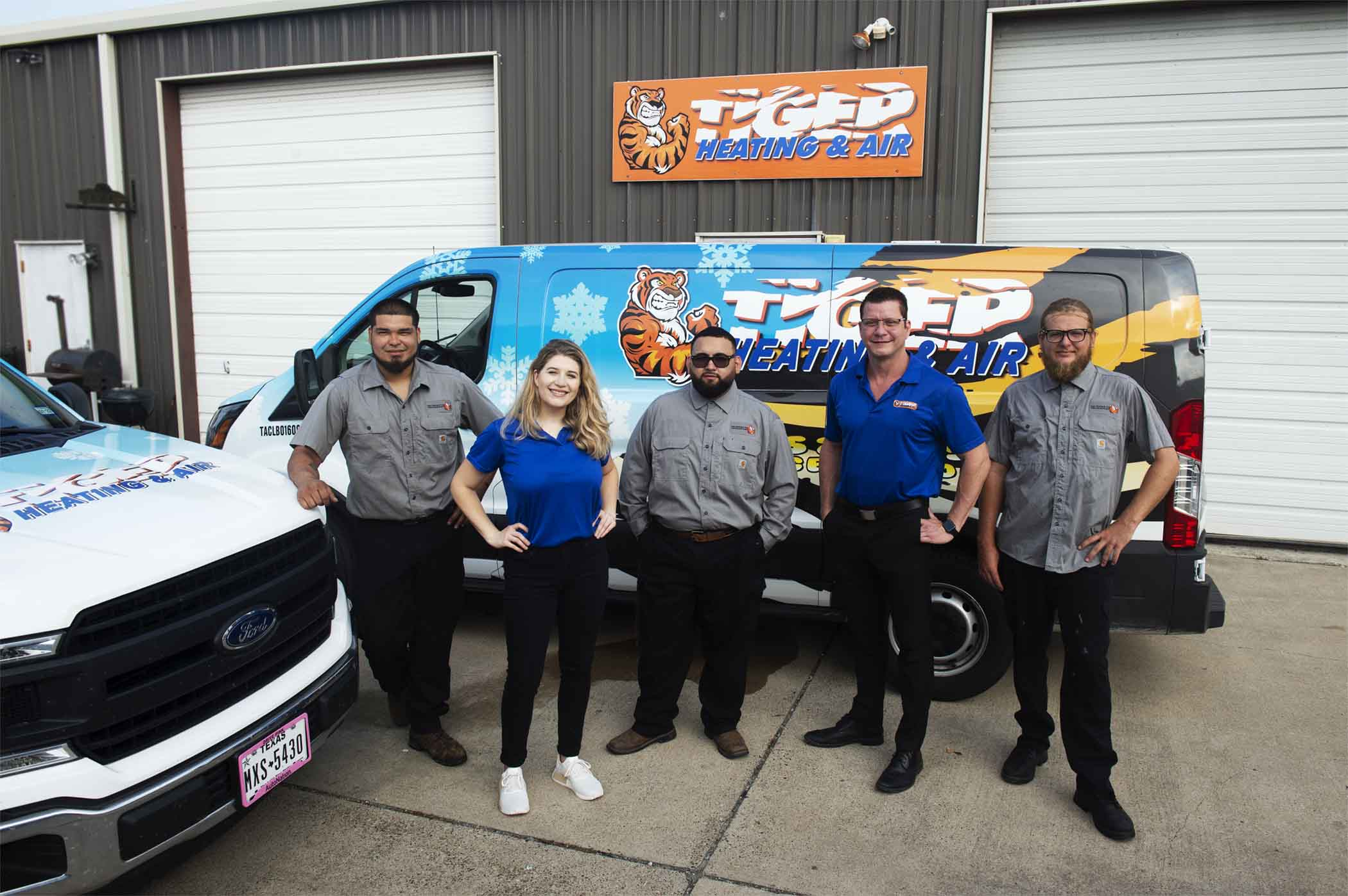 Photo of Tiger HVAC team outside shop