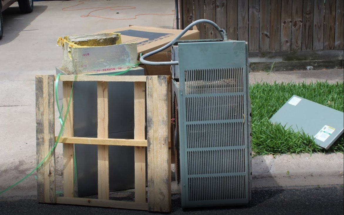 Old AC with low SEER rating getting replaced and is on the curb of a Corpus Christi neighborhood
