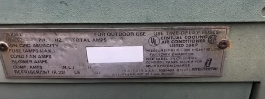 AC sticker label showing R-22 as the refrigerant on an old unit