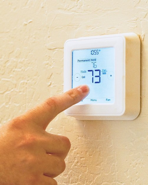 Thermostat set to 73 degrees, something to check when an AC blows hot air