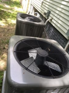 Photo of 2 AC units installed outside home